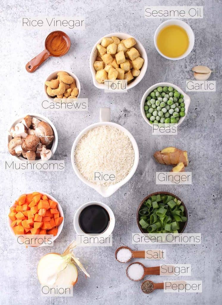 Ingredients for vegan fried rice on a cement countertop