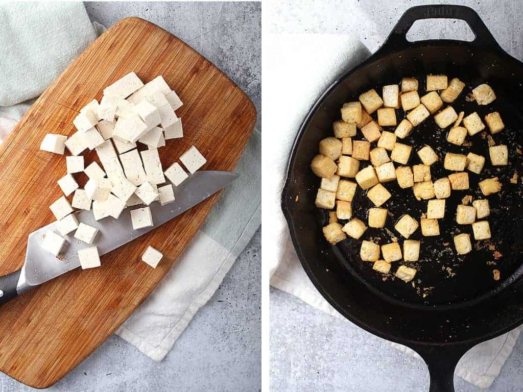 Cubed and sautéed tofu in a cast iron skillet