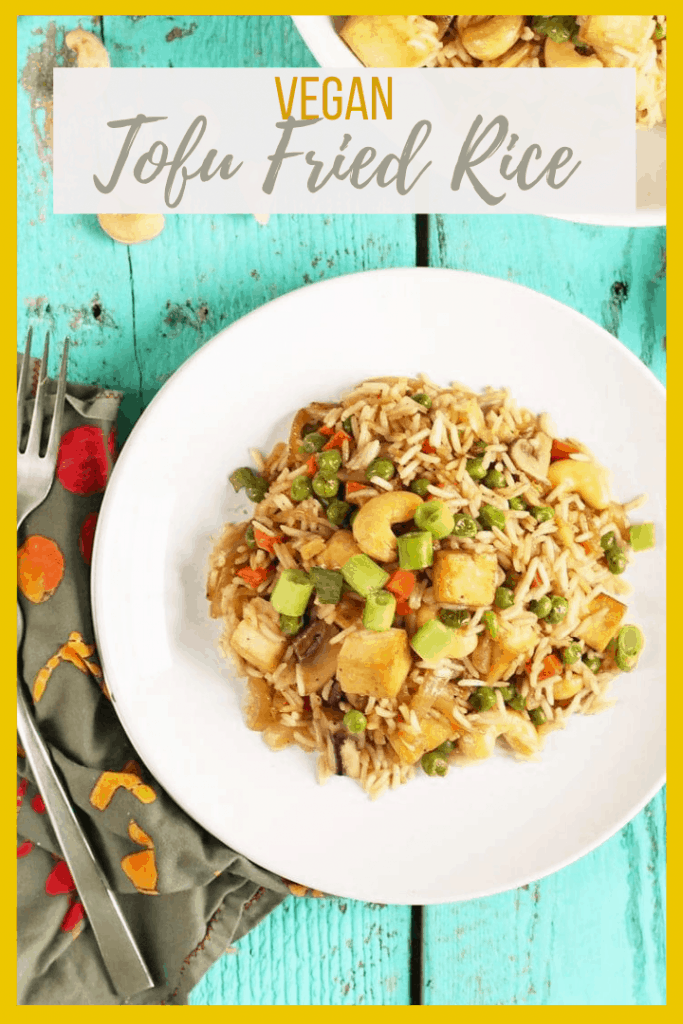 Make take-out at home! This Tofu Fried Rice is made with crispy tofu, carrots, peas, and cashews for a hearty and delicious plant-based and gluten-free meal the whole family will love.