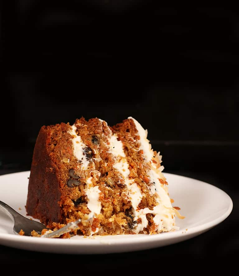 Slice of Gluten Free Carrot Cake on white plate
