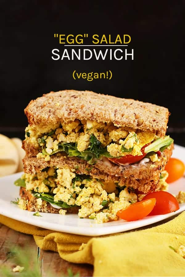 This refreshing vegan egg salad sandwich is made with scrambled tofu mixed with fresh herbs and spices and topped with mixed greens and fresh tomatoes. #vegan #vegetarian #veganeggs #vegansandwich #lunch #recipes #mydarlingvegan
