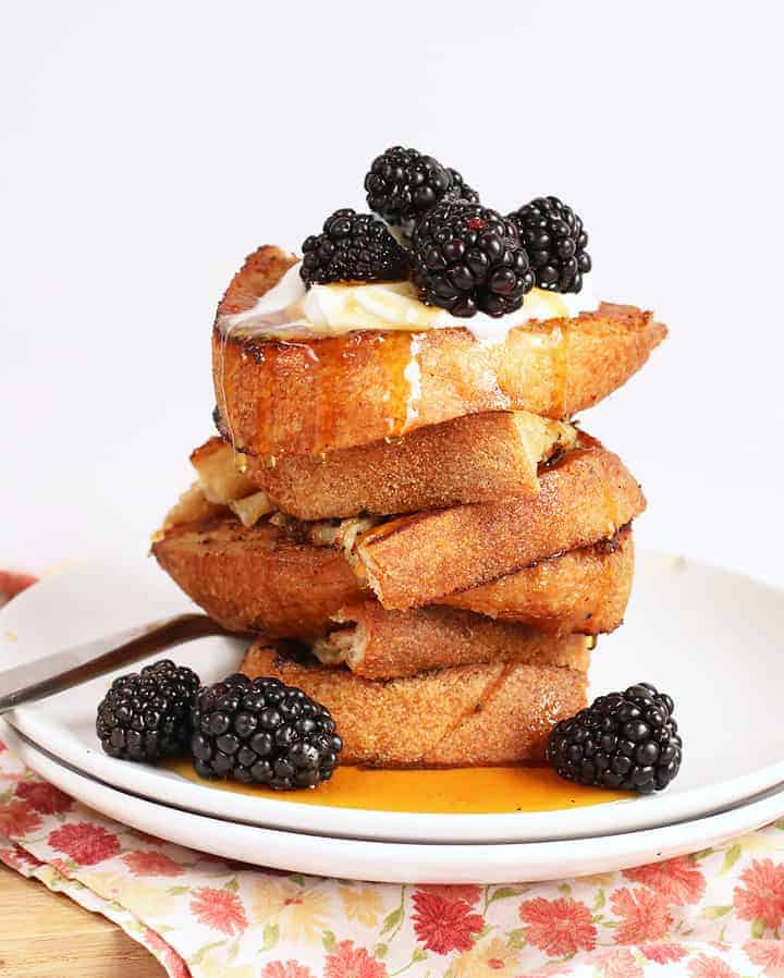 Stack of Vegan French Toast on a white plate