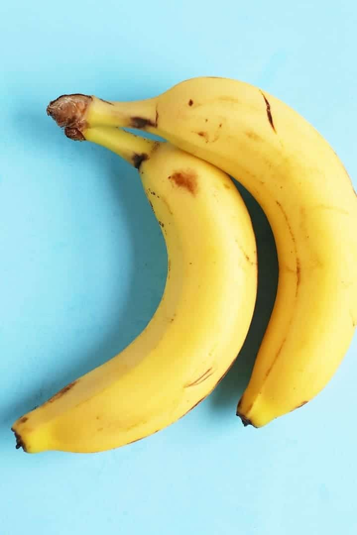 Two bananas on blue background