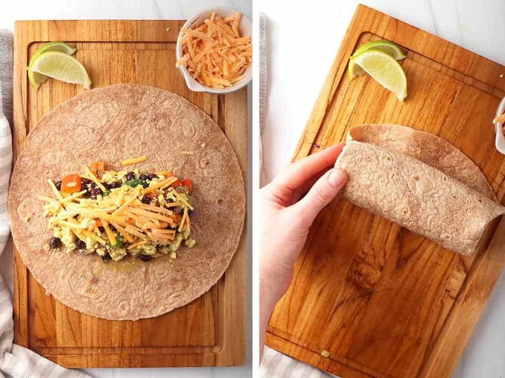 Breakfast burrito on a cutting board wrapped up