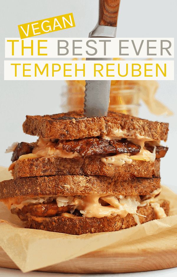 A vegan tempeh reuben made with marinated tempeh, creamy Russian dressing, and sauerkraut sandwiched between two pieces of seedy rye bread #vegan #tempeh #veganrecipes #vegansandwiches