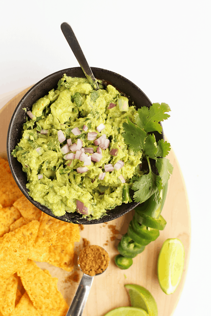 Homemade Guacamole in a small black bowl
