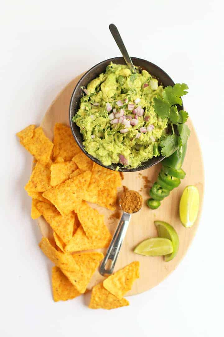 Easy Guacamole in a bowl with chips