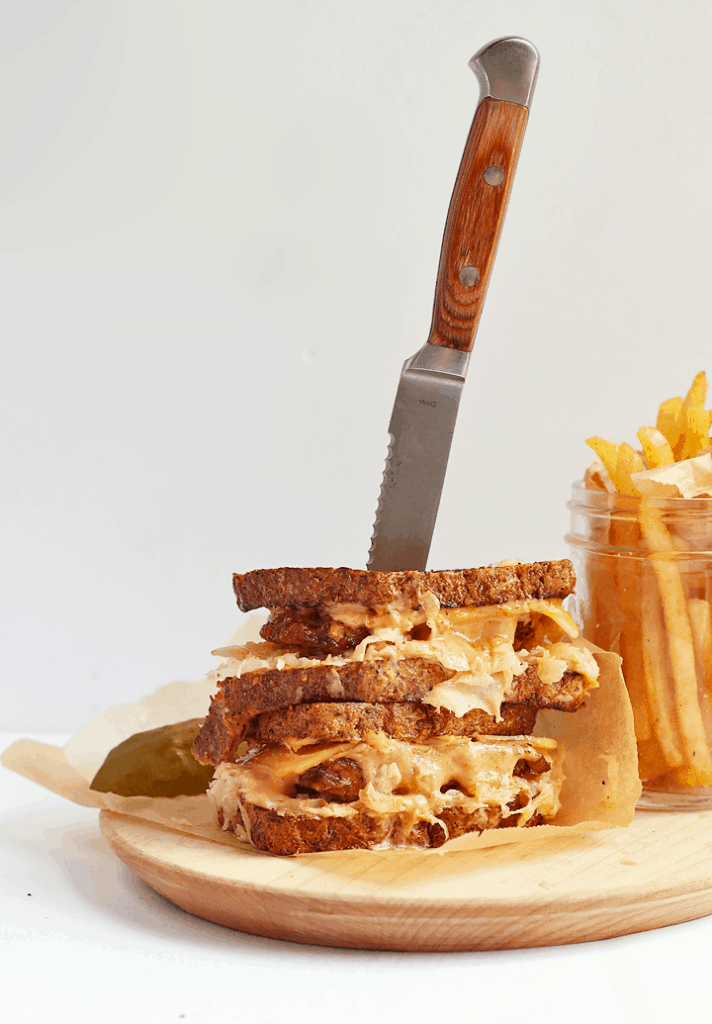 Vegan Tempeh Reuben on a wooden platter