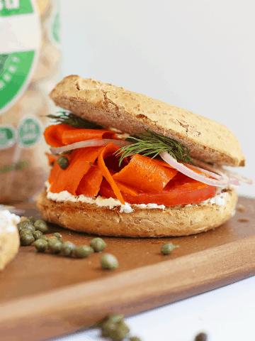 Bagel and Carrot Lox Sandwich on a wooden platter