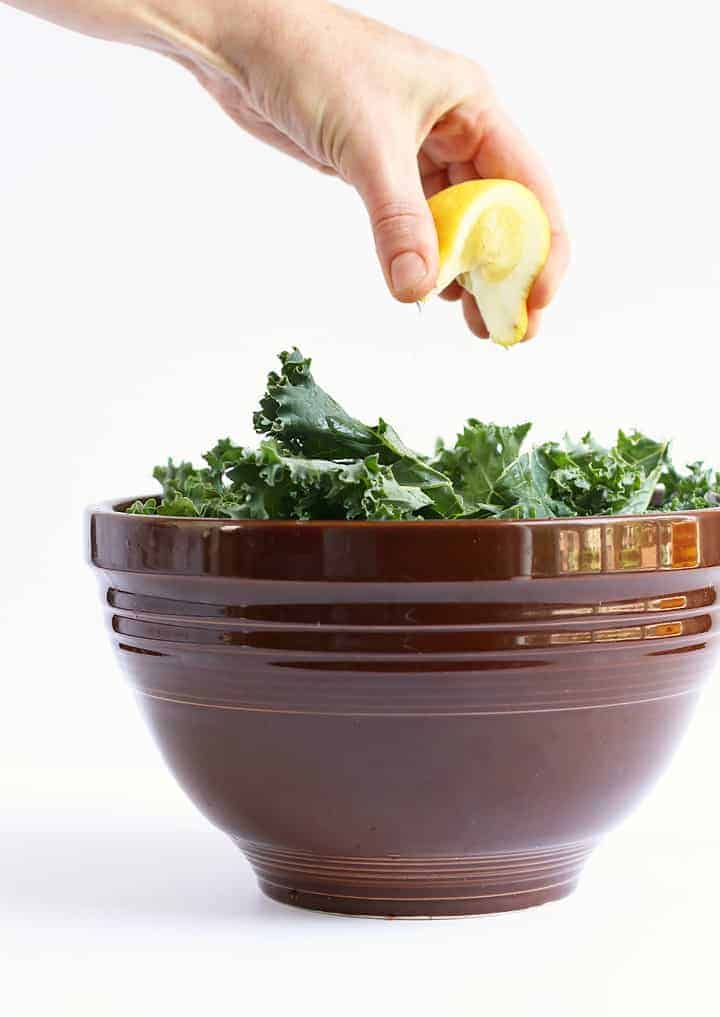 Bowl of kale with freshly squeezed lemon