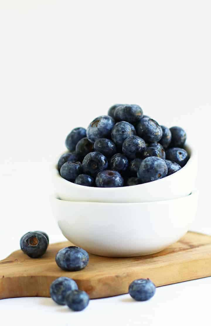 Fresh blueberries in a small white bowl