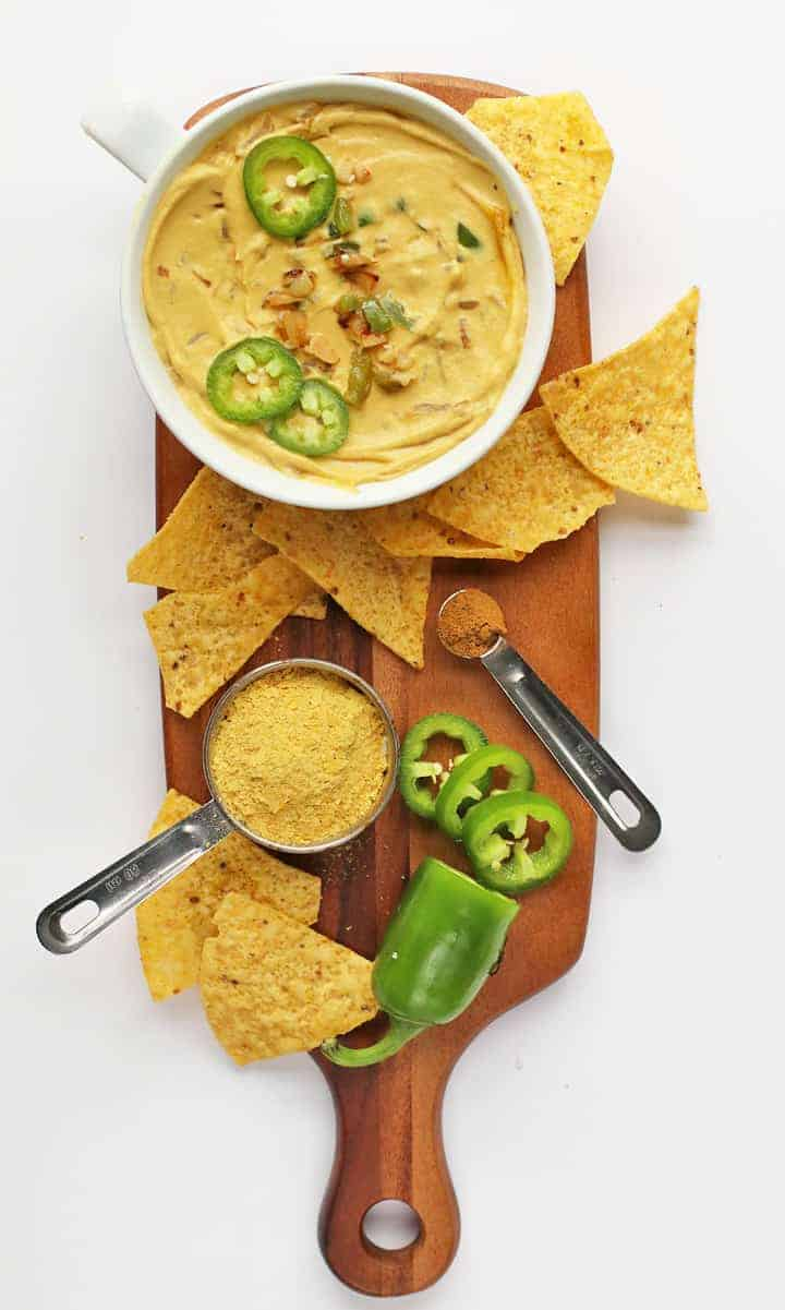 Finished recipe on a wooden board with tortilla chips