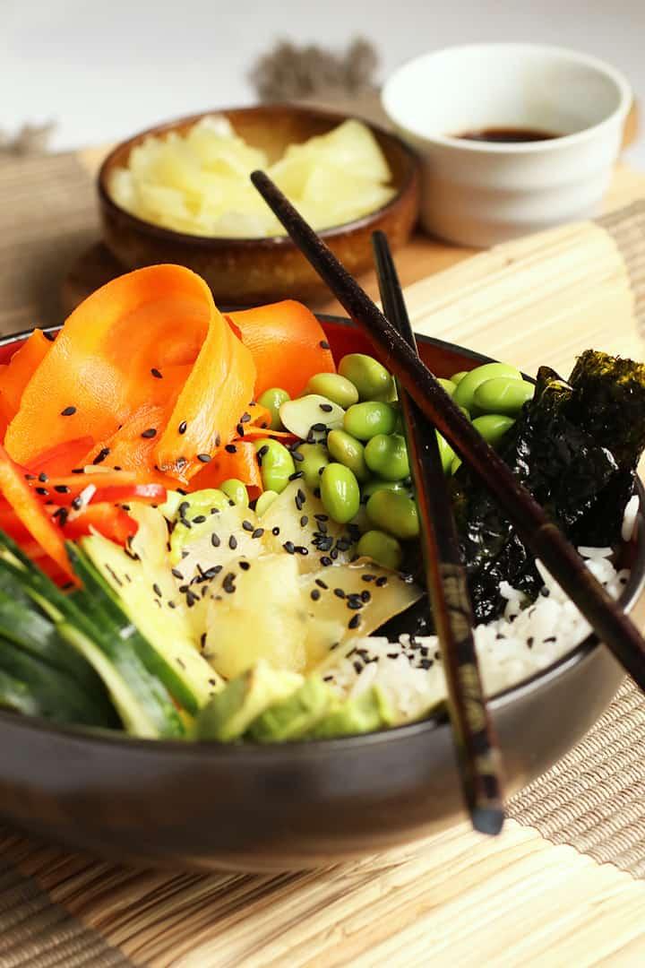 Vegan Sushi Bowl in a black bowl with chopsticks