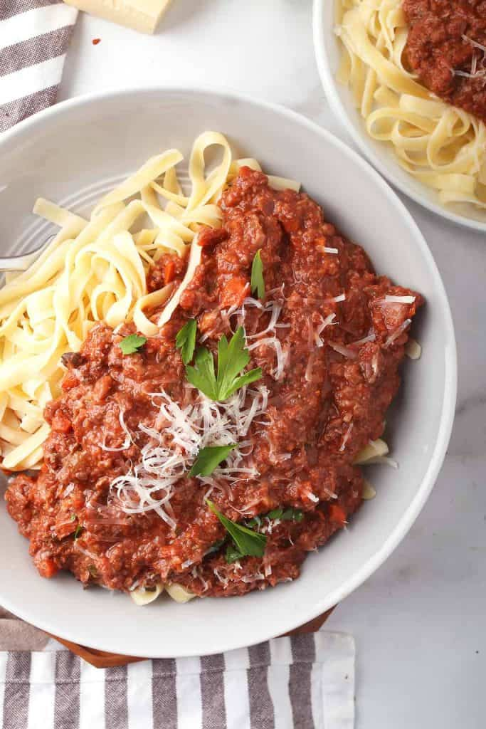 Plate of vegan pasta with bolognese sauce