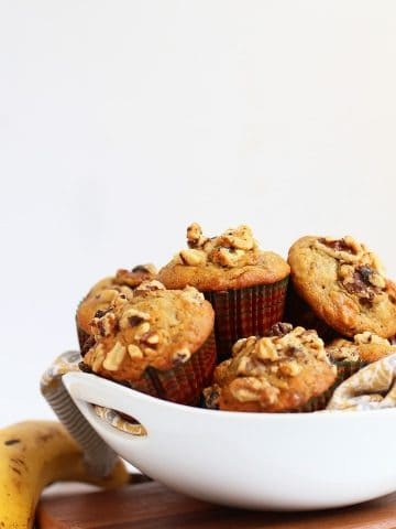 Finished muffins stacked inside a white bowl