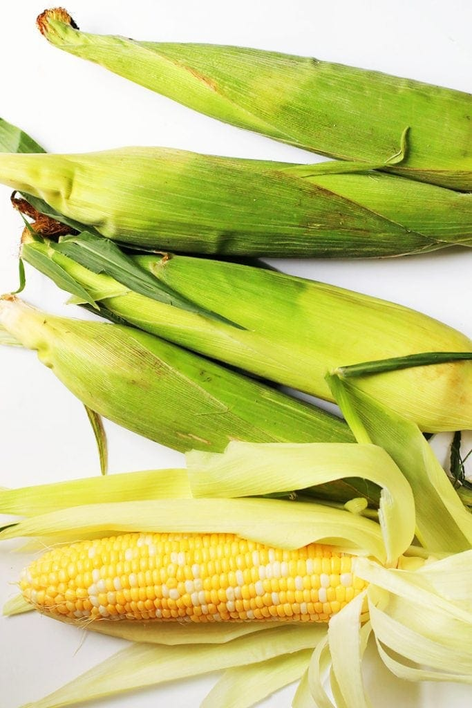 5 Corn on the cob on a white background