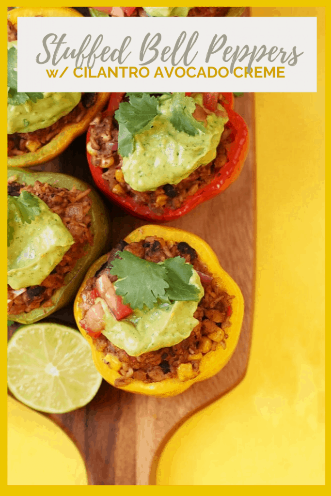 These Mexican-Style Vegan Stuffed Peppers are perfect! They are filled with tempeh, corn, beans, and spices and topped with a homemade avocado cream for a delicious and healthy vegan and gluten-free meal.