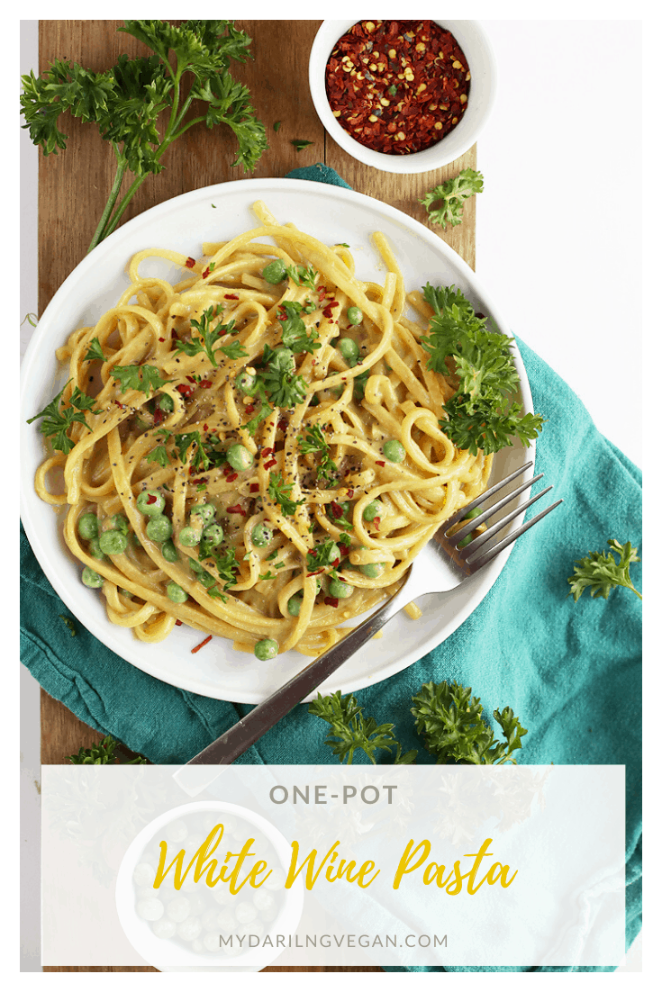 Make dinner easy with this delicious 30 minute one-pot vegan Garlic White Wine Pasta topped with fresh parsley, peas, and red pepper flakes.