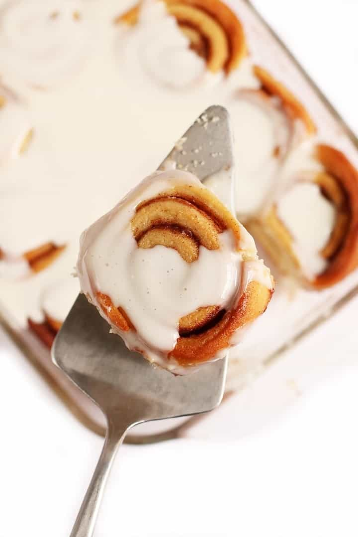 Finished cinnamon roll on a metal spatula