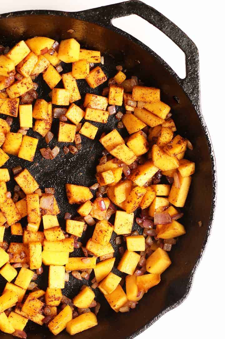 Sautéed squash and onions in cast iron skillet