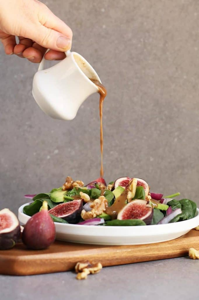 Balsamic Vinaigrette poured over finished salad