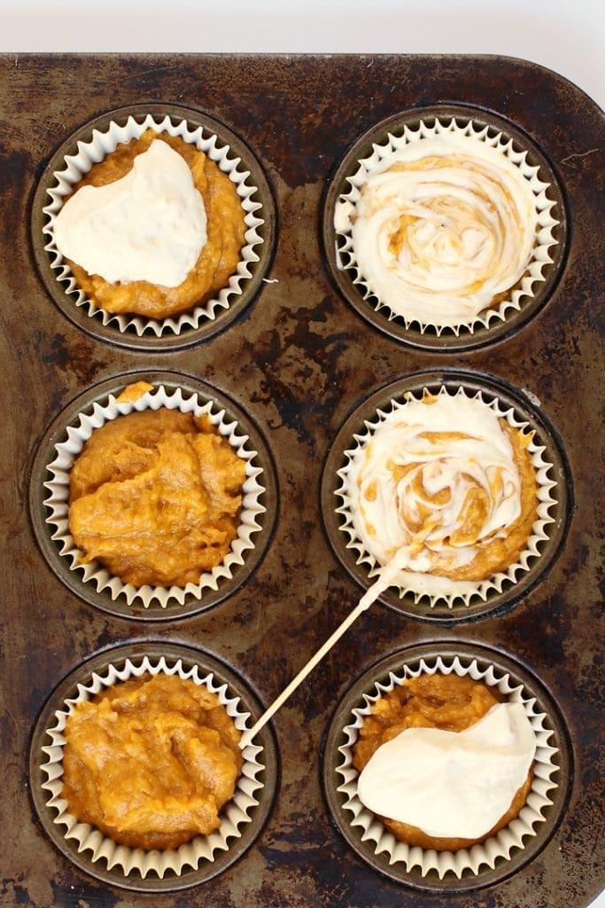 Pumpkin muffin batter in a muffin tin