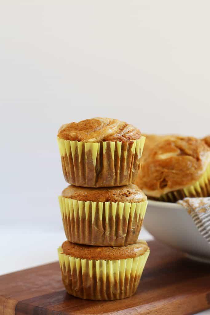 Stack of three Pumpkin Cream Cheese Muffins