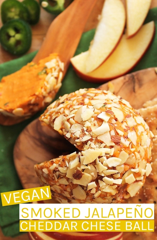 A simple vegan cheddar cheese with jalapeño ball covered in slivered almonds; the perfect spread for your next party. Serve with fruit and crackers. #vegan #veganrecipes #vegancheese #cheeseball #partyfood