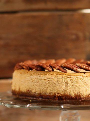 Vegan Pumpkin Cheesecake on a glass cake stand