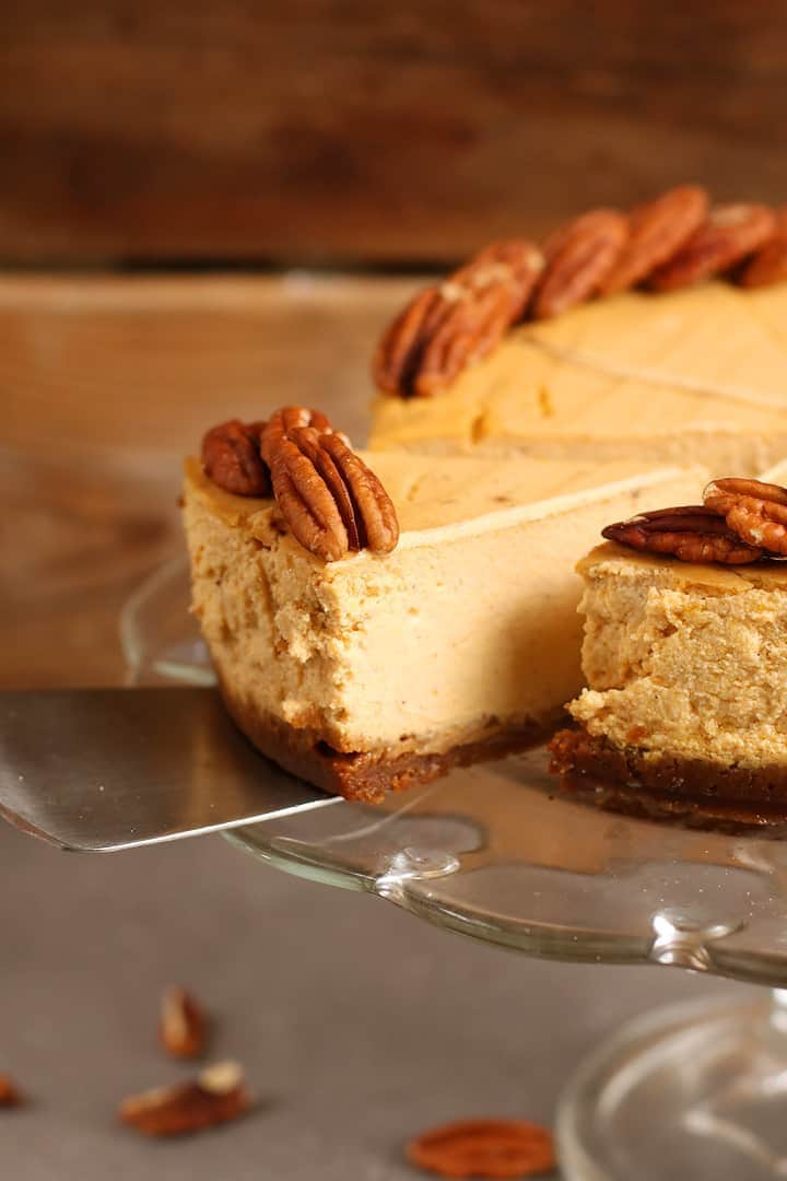 Close up of vegan Pumpkin Cheesecake with gingersnap crust.