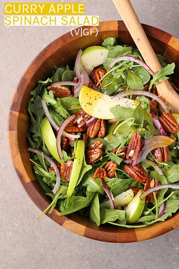 This Curry Apple Spinach Salad is the perfect fall salad. It is a mixture of spinach and arugula tossed with apples, pecans, and curry vinaigrette dressing.