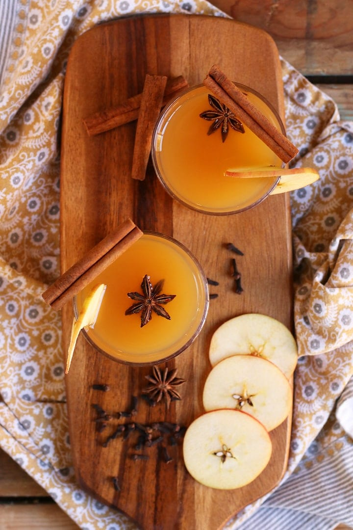 Bourbon Apple Cider on wooden platter