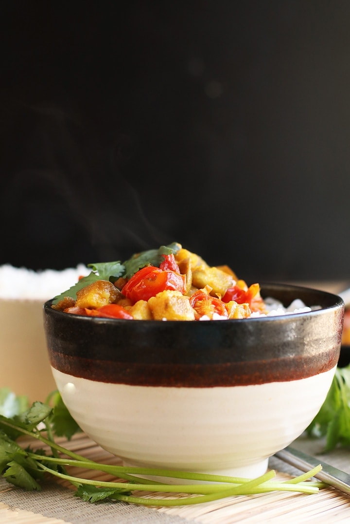 Eggplant Chickpea Curry in a black and white bowl