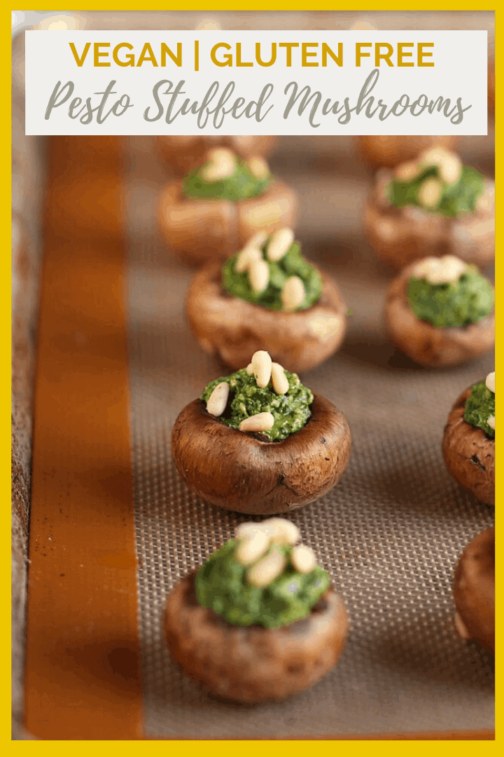 These vegan Pesto-Stuffed Mushrooms are the perfect appetizer for your holiday parties. Made with baby portobellos stuffed with fresh arugula basil. Vegan and Gluten-Free