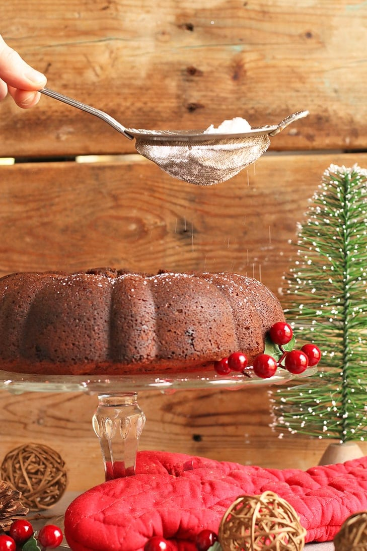 Powdered sugar dusted onto a gingerbread cake