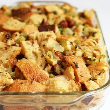 Vegan stuffing in a glass casserole dish.