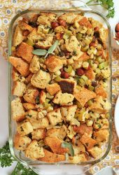 Vegan stuffing in a glass casserole dish.