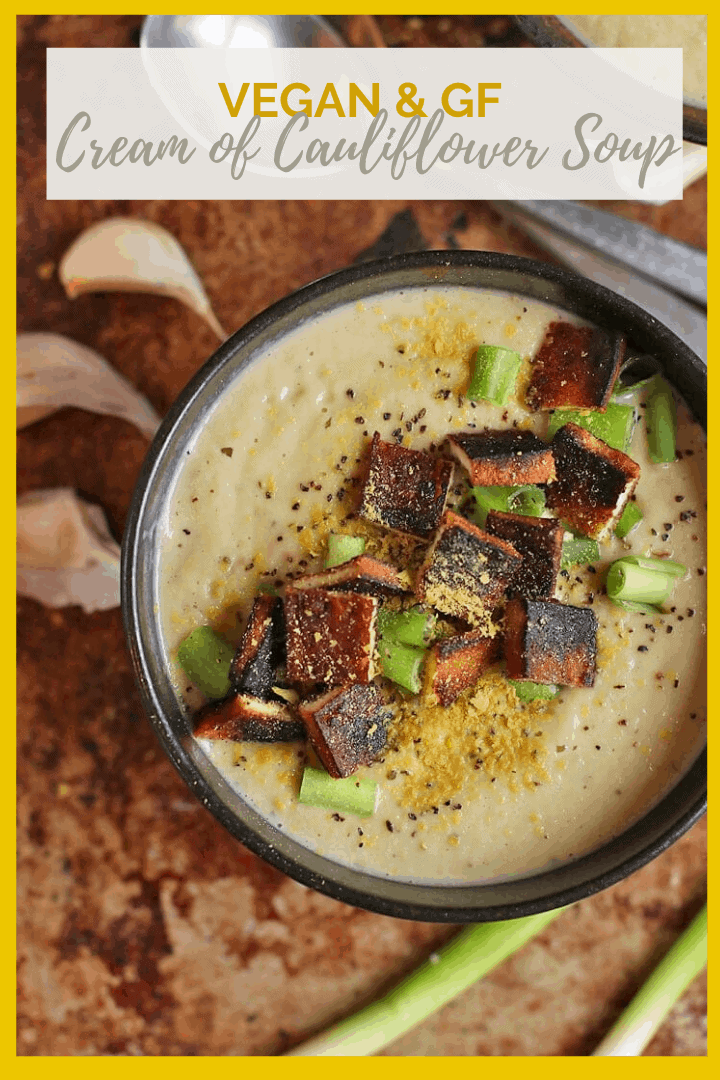 This Vegan Cream of Cauliflower Soup is so rich and creamy! It's made with cashew cream, creamy cauliflower, and nutritional yeast and topped with tofu bacon for a delicious gluten-free meal.