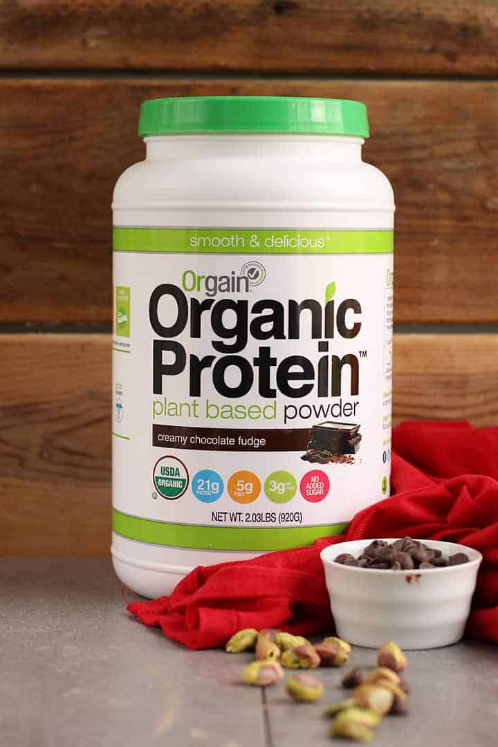 Tub of Orgain Chocolate Protein Powder