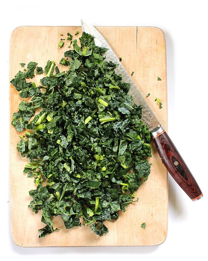 Chopped Kale on a cutting board with a knife