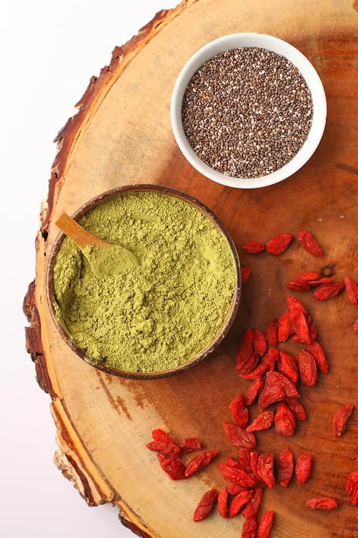 Matcha powder, chia seeds, and goji berries