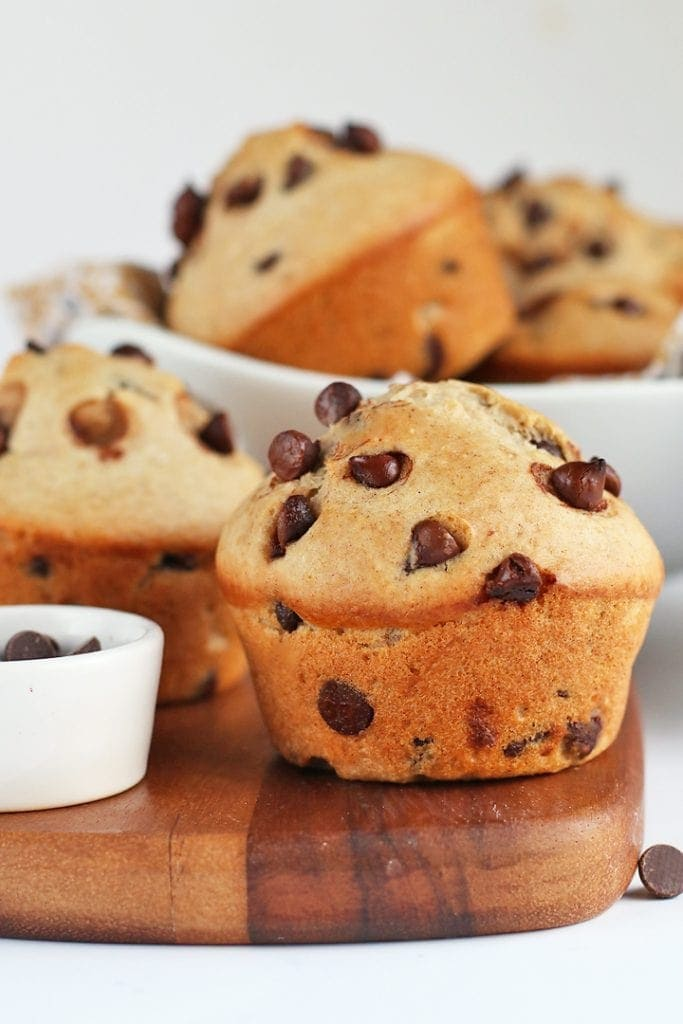 Vegan Chocolate Chip Muffins on a wooden board