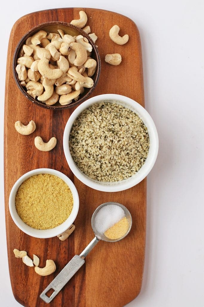 Cashews, hemp hearts, and nutritional yeast on a wooden board
