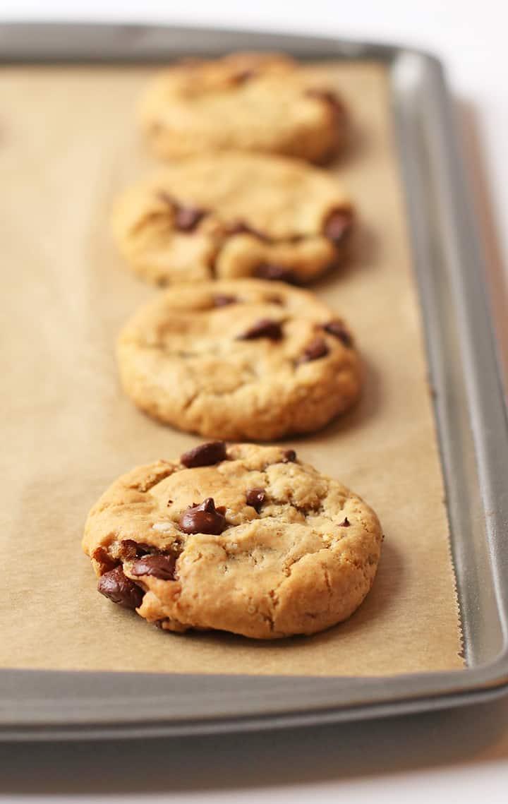 Vegan Chocolate Chip Cookies on a sheet pan