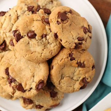 A white plate filled with Vegan Chocolate Chip Cookies