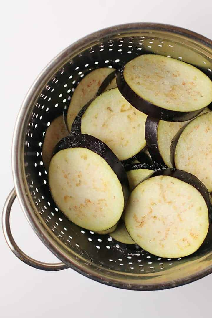 Eggplant slices in a colander