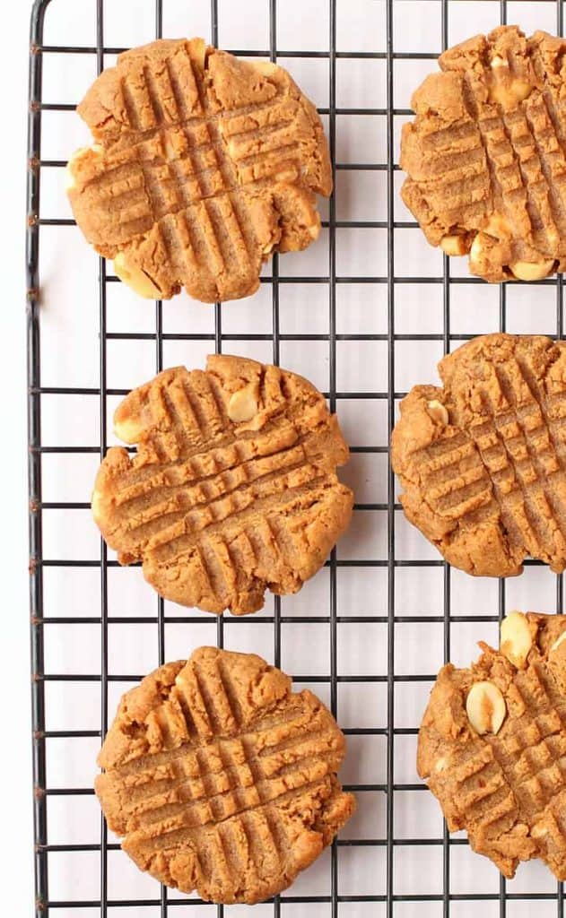 Peanut butter cookies on a wire cooling rack
