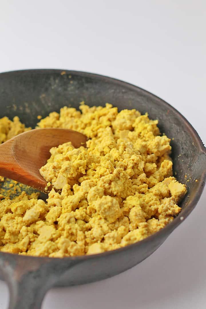 Tofu scrambled eggs in a cast iron skillet
