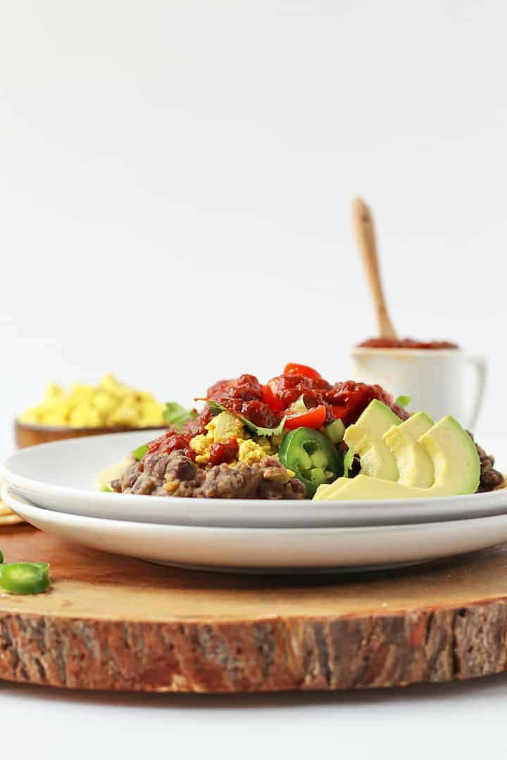 Vegan Huevos Rancheros on a wooden platter