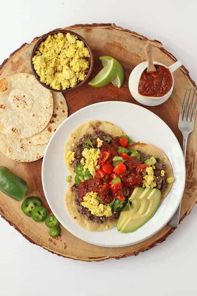 Vegan rancheros with salsa, avocado, and lime.